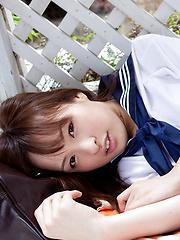 Maho Kimura Asian undresses school uniform right in the park