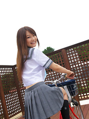 Misaki Nito Asian in school uniform goes to classes riding bike