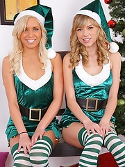 2 smoking hot perky titty blondes get fucked hard against the christmas tree in these hot fucking sexy cumfaced pics