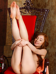 Hot and fiery like a chili, redhead stunner Halena A loves setting your hearts on fire with libidous desires as she shows off her petite body with smooth skin, small but pink breasts, and decadent, sweet pussy.