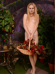 Amazing petite blonde gives you a taste of heaven as she poses naked holding her bag of fruits.