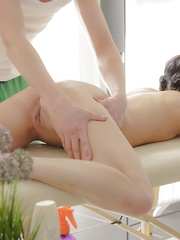 Teen couple screwing on the massage table