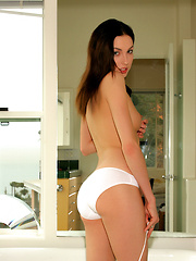 Guinevere gets horny and naughty on the tub caressing her soapy, wet body
