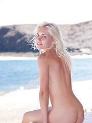Naked and uninhibited, the fun and   carefree Cristina shamelessly spreads   her legs and bares her delectable   assets with the cool and refreshing   beach as the background.